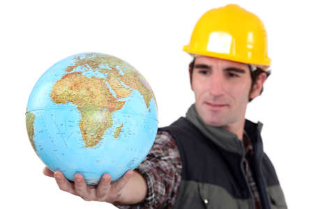 Tradesman holding a globe photo
