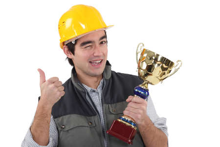 young craftsman winking holding trophy photo