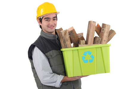 Man holding recycle box full of scrap wood photo