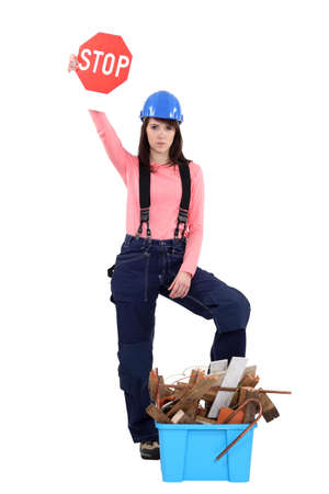 re employment: Woman stopping construction waste