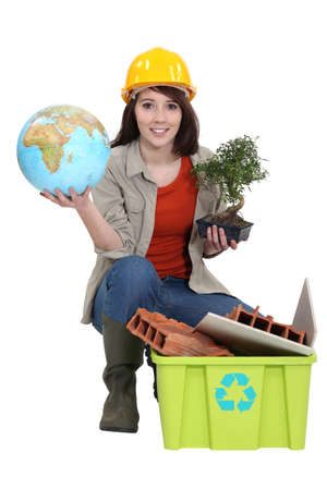 craftswoman posing with recycling tub and globe photo