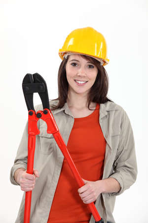 young female apprentice holding giant pliers Stock Photo - 16191495