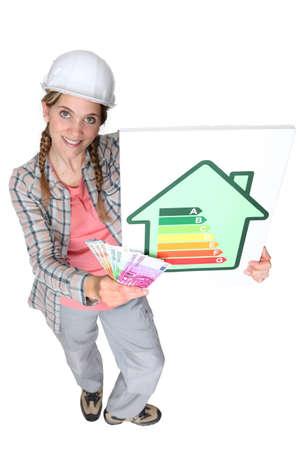 craftswoman: craftswoman holding energy consumption label