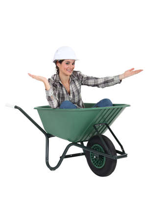barrow: Woman sat in wheelbarrow