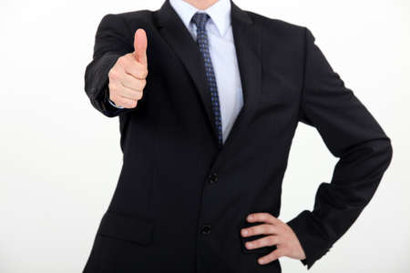 businessman making a thumbs up sign Stock Photo - 16227364