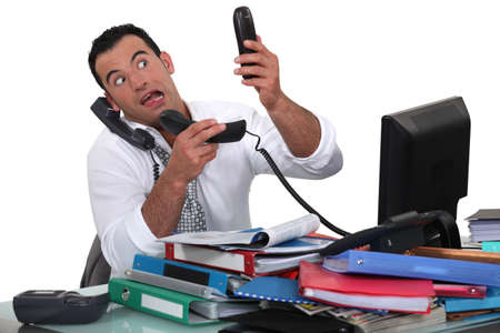 workaholic: Office worker trying to answer multiple phones