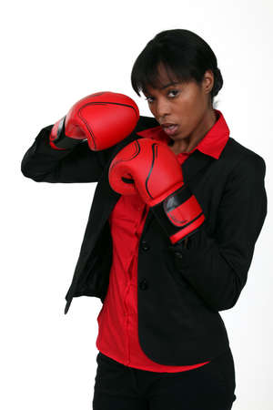 woman 40 years: Businesswoman wearing boxing gloves