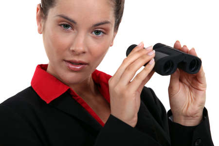 Woman holding a pair of binoculars Stock Photo - 16190770