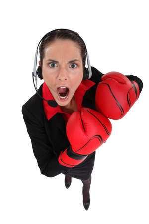 earing: Businesswoman earing boxing gloves