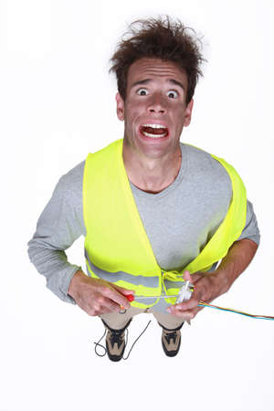 suffer: Man being electrocuted Stock Photo
