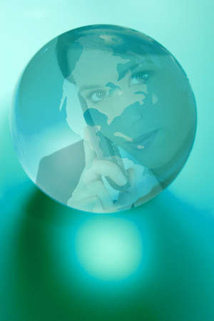 photomontage: Photo-montage of woman on phone in a globe