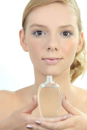 pink lips: Woman with perfume bottle