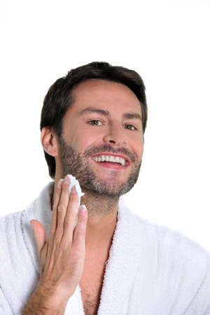 appeals: man shaving off his beard Stock Photo