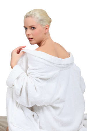 Woman taking off robe
