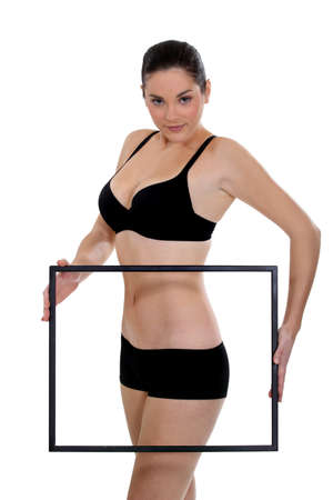 Slender woman holding a frame around her hips photo