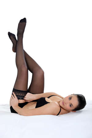 Attractive and sexy woman putting pantyhoses photo