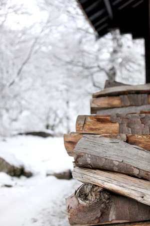 Woodpile outside a cabin photo