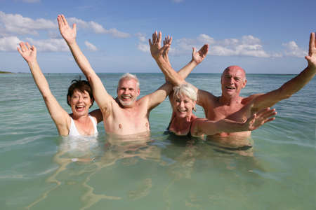 swimmers: Retired people swimming in the ocean