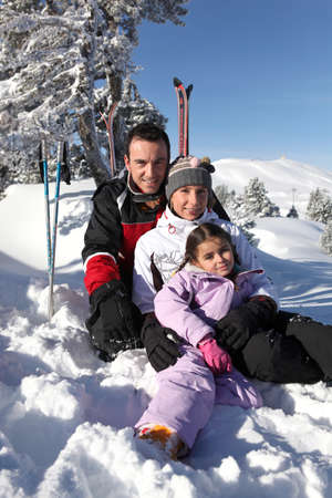 Family on a skiing holiday photo