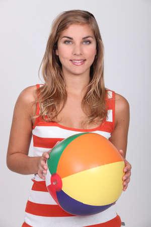 beach ball girl: Young blond woman holding beach ball