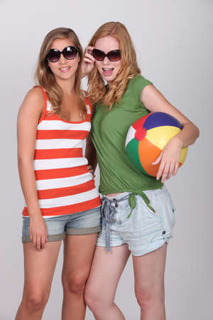 Two teenage girls dressed for summer fun photo