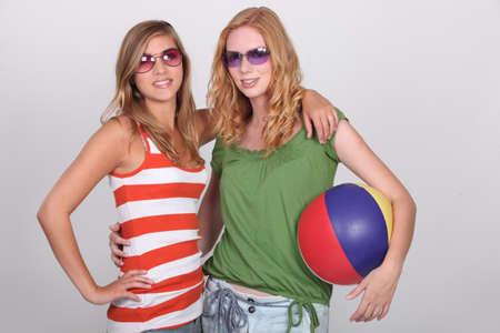 beach ball girl: Girls equipped for the beach Stock Photo
