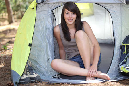 woman sat in tent photo