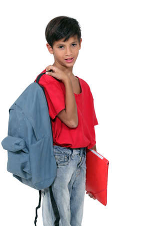 little schoolboy holding a backpack and a file folder Stock Photo - 16230445