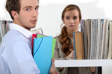 hardworker: Colleagues surrounded by file folders Stock Photo