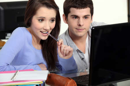 coursework: Students working at a laptop