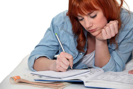 freshmen: Young woman completing her homework