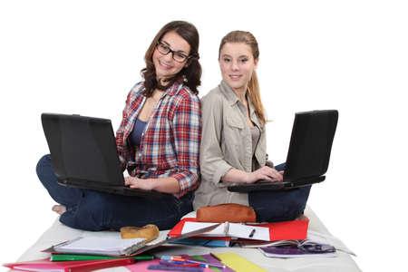 studygroup: Two female students with laptops Stock Photo