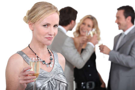 Blond woman holding up champagne Stock Photo - 16230539