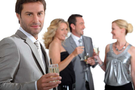 Four colleagues drinking champagne Stock Photo - 16236877
