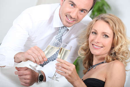 Couple drinking champagne Stock Photo - 16236912