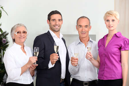 a family toasting with sparkling wine Stock Photo - 16236865