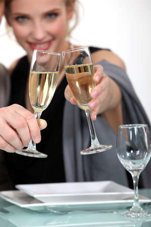 A couple celebrating with a glass of champagne Stock Photo - 16228077