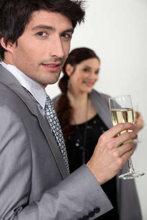 after party: Elegant man drinking champagne