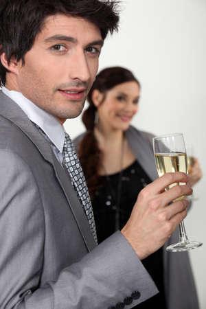 suave: Elegant man drinking champagne
