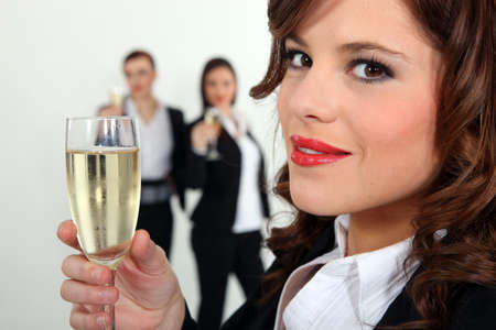 office party: Women in smart suit with glass of champagne