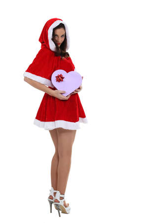 Saucy Miss Santa with a heart shaped giftbox Stock Photo - 16227488