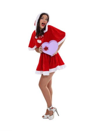 mrs claus: Young woman in a saucy Santa outfit