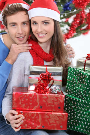 young couple celebrating Christmas Stock Photo - 16237098