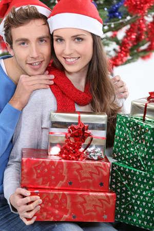 young couple celebrating Christmas Stock Photo - 16237098