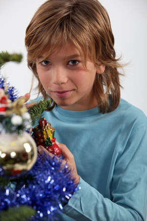 Boy with a Christmas Tree Stock Photo - 16236917
