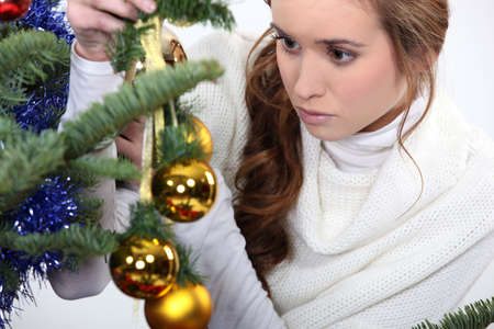 damsel: pretty damsel watching Christmas decoration
