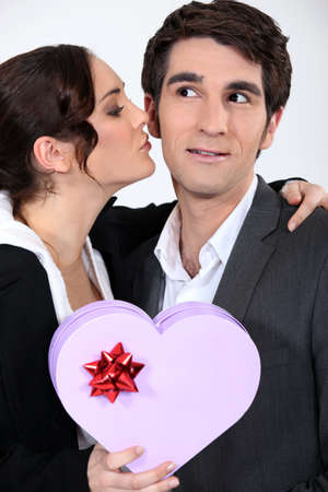 Woman kissing man with gift Stock Photo - 16237074
