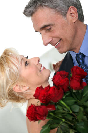 intimacy: Romantic couple with red roses