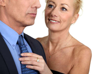 foreplay: Wife helping husband with tie