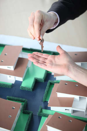 scale model: Handing over keys to a new house